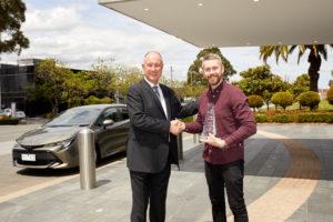 RACV's Tim Nicholson (r) presents Toyota Australia's Sean Hanley with Australia's Best Car awards