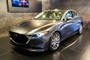 """Alt=""""Mazda sedan in showroom background"""""""