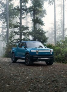 """alt=Rivian R1T in the forest"""">"""